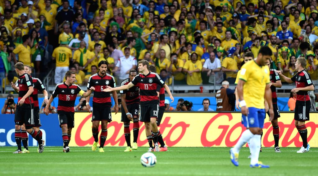 Germany's Thomas Muller (6th L) celebrates with teammates after scoring during a semifinal match between Brazil and Germany of 2014 FIFA World Cup at the ...