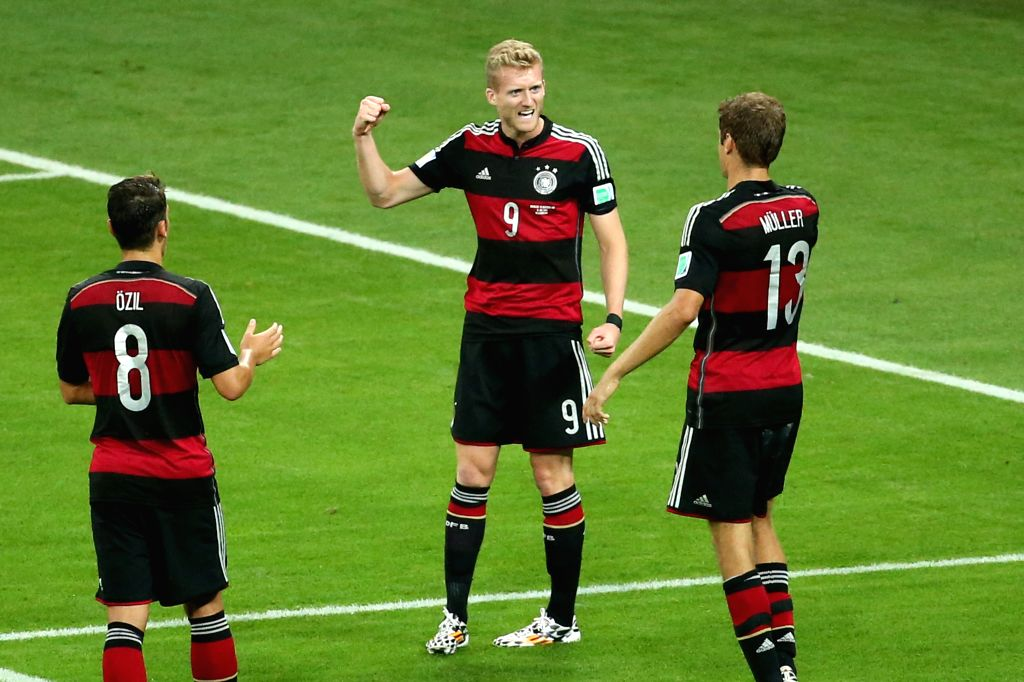 Germany's Andre Schuerrle (C) celebrates a goal during a semifinal match between Brazil and Germany of 2014 FIFA World Cup at the Estadio Mineirao Stadium in .
