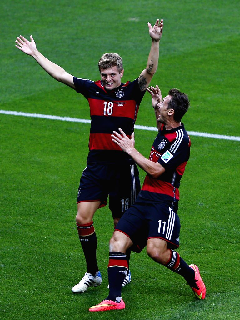 Germany's Toni Kroos (L) celebrates a goal during a semifinal match between Brazil and Germany of 2014 FIFA World Cup at the Estadio Mineirao Stadium in Belo .