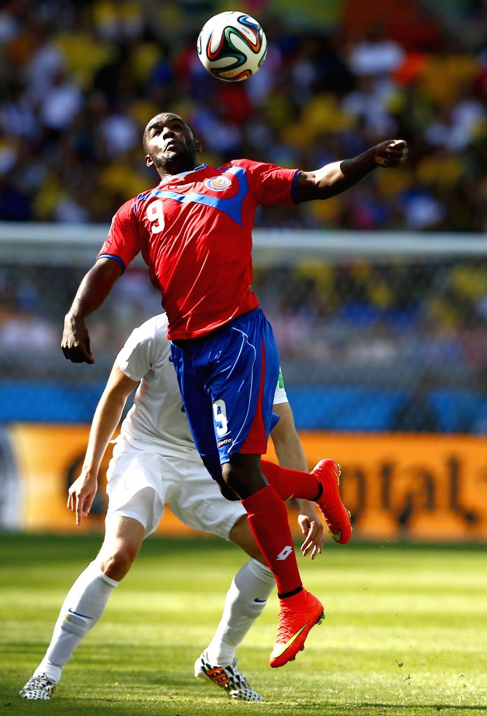 Costa Rica's Joel Campbell (front) competes for a header during a Group D match between Costa Rica and England of 2014 FIFA World Cup at the Estadio Mineirao ... - Campbell
