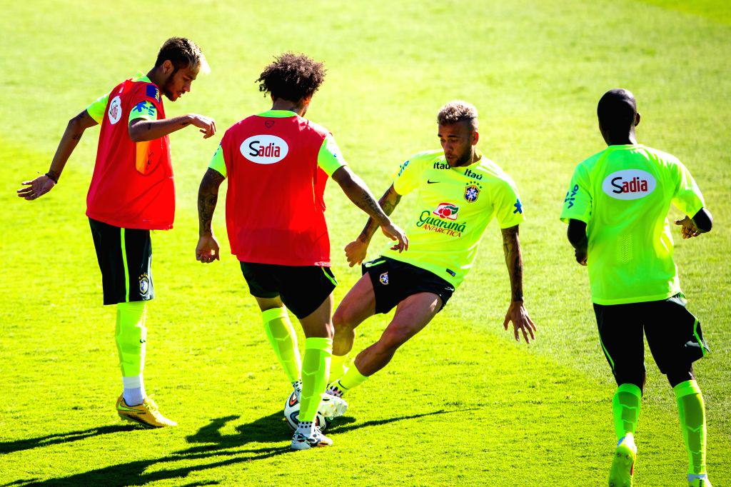 Players of Brazil's national football team participate in a training session in Belo Horizonte, Brazil, June 27, 2014. Brazil's national football team ...