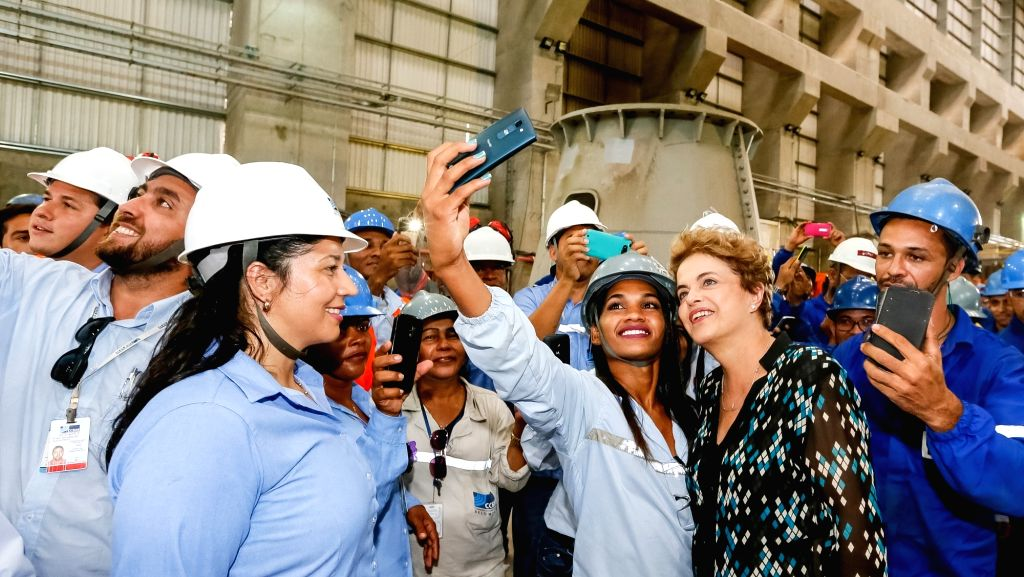 """BELO MONTE, May 5, 2016 - Image provided by Brazil's Presidency shows Brazilian President Dilma Rousseff (2nd R) posing for a """"selfie"""" in the launching ceremony of the hydroelectric power ..."""