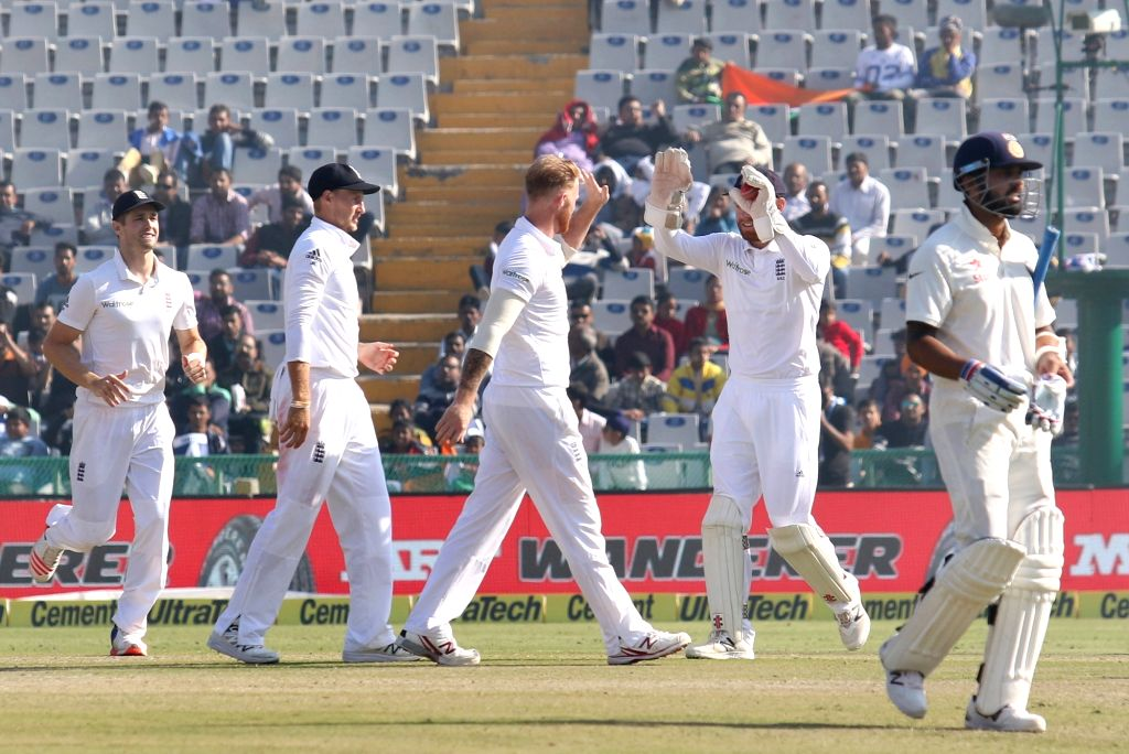 Ben Stokes of England celebrates fallof a wicket on Day 2 of the third test match between India and England at Punjab Cricket Association IS Bindra Stadium, Mohali on Nov 27, 2016.