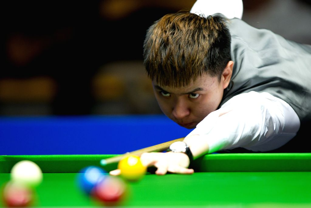 Xiao Guodong of China competes during his semifinal match against Judd Trump of Great Britain at the 2014 Australian Goldfields Snooker Open in Bendigo, Australia, ..
