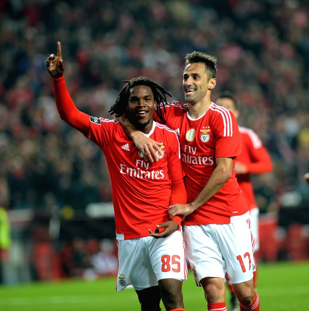 Benfica's Renato Sanches (L) celebrates with teammates Jonas during 12th round of the Portuguese League Football Match between SL Benfica and A. Academica at the Luz ...