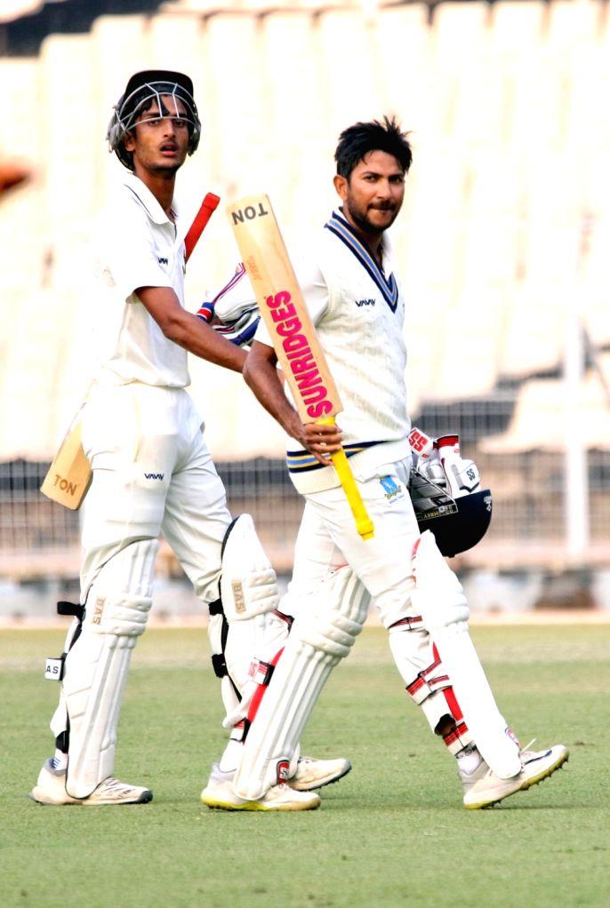 Bengal's Anustup Majumdar and Shahbaz Ahmed during a Ranji Trophy match between Delhi and Bengal at the Edeen Gardens in Kolkata on Jan 27, 2020.