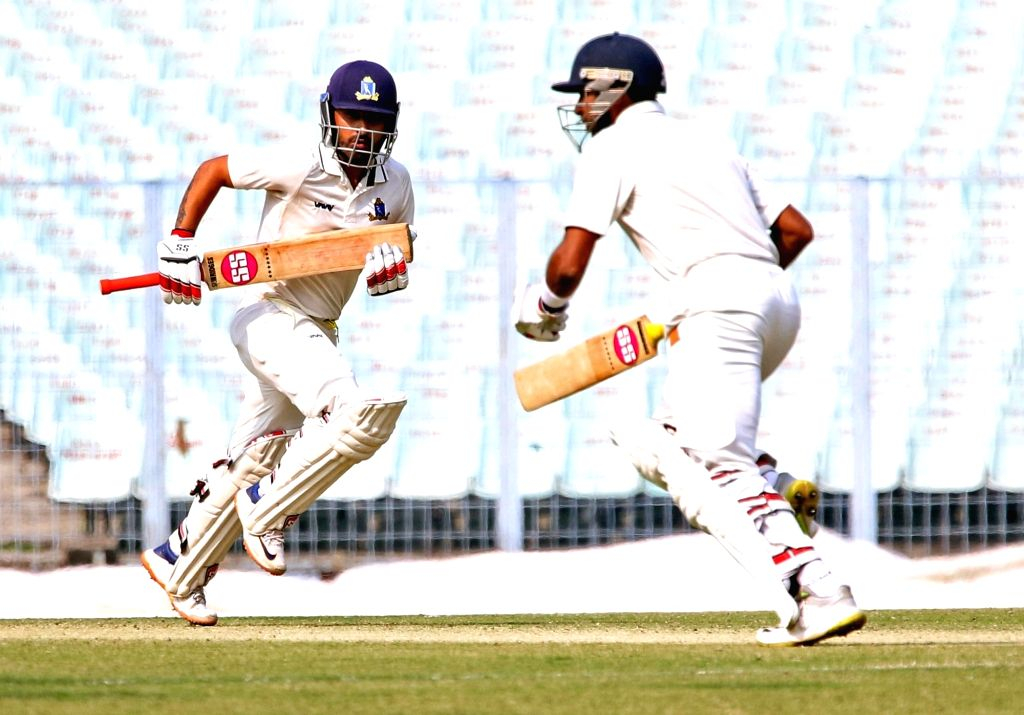 Bengal's Shreevats Goswami and Anustup Majumdar in action during a Ranji Trophy match between Delhi and Bengal at the Edeen Gardens in Kolkata on Jan 27, 2020. - Shreevats Goswami