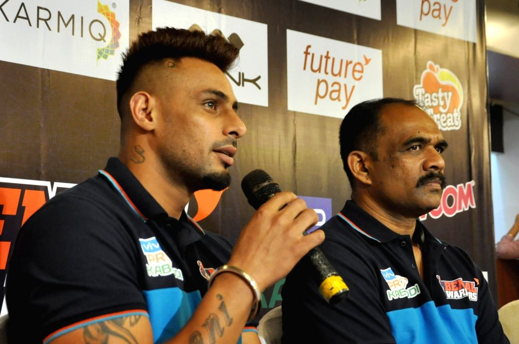 Bengal Warrior captain Maninder Singh accompanied by coach BC Ramesh, addresses a press conference, in Kolkata on Sep 6, 2019. - Maninder Singh