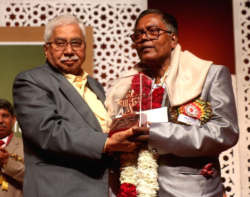 Bengali author Afsar Ahmed being awarded by Sahitya Akademi Vice President Chandrashekhara Kambar during the Sahitya Akademi Awards in New Delhi on Feb 12, 2018.