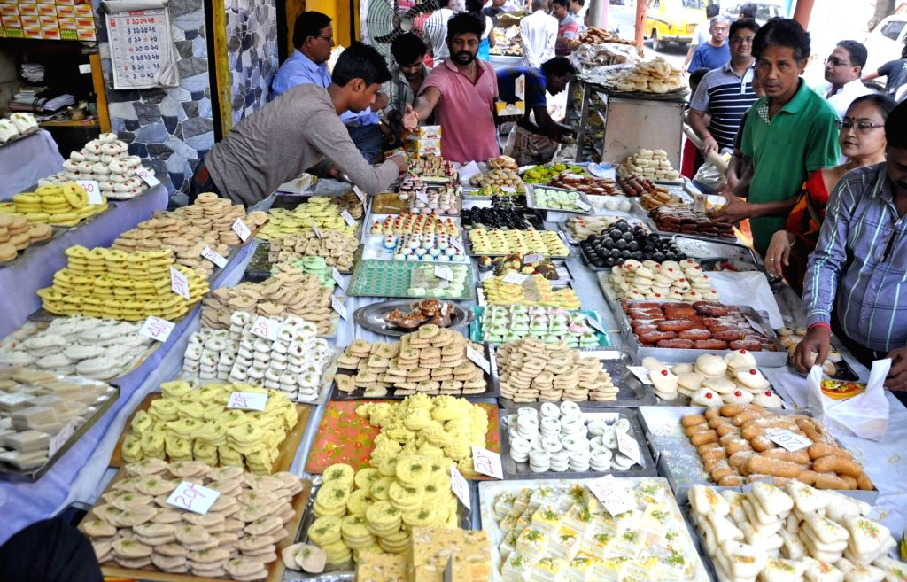 Bengalis can relish their favourite rosogolla, sandesh and mishti doi (sweet yoghurt) from Tuesday with the West Bengal government permitting sweetmeat shops to remain open for four hours daily during the lockdown period. (Photo: Kuntal Chakrabarty/I