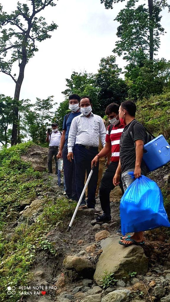 Bengals Alipurduar DM braves hills, jungle to vaccinate villagers.