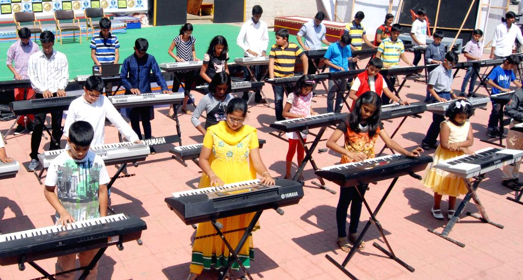 350 children play keyboard at a time during a programme organised at Samsa open stage in Bengaluru, on Feb 22, 2015.