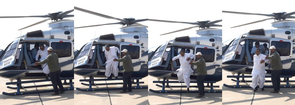 (A combo picture)Karnataka Chief Minister Siddaramaiah deboards a helicopter after a fire broke out in its silencer in Bengaluru on Jan 10, 2015. The chief minister and 3 others were ... - Siddaramaiah