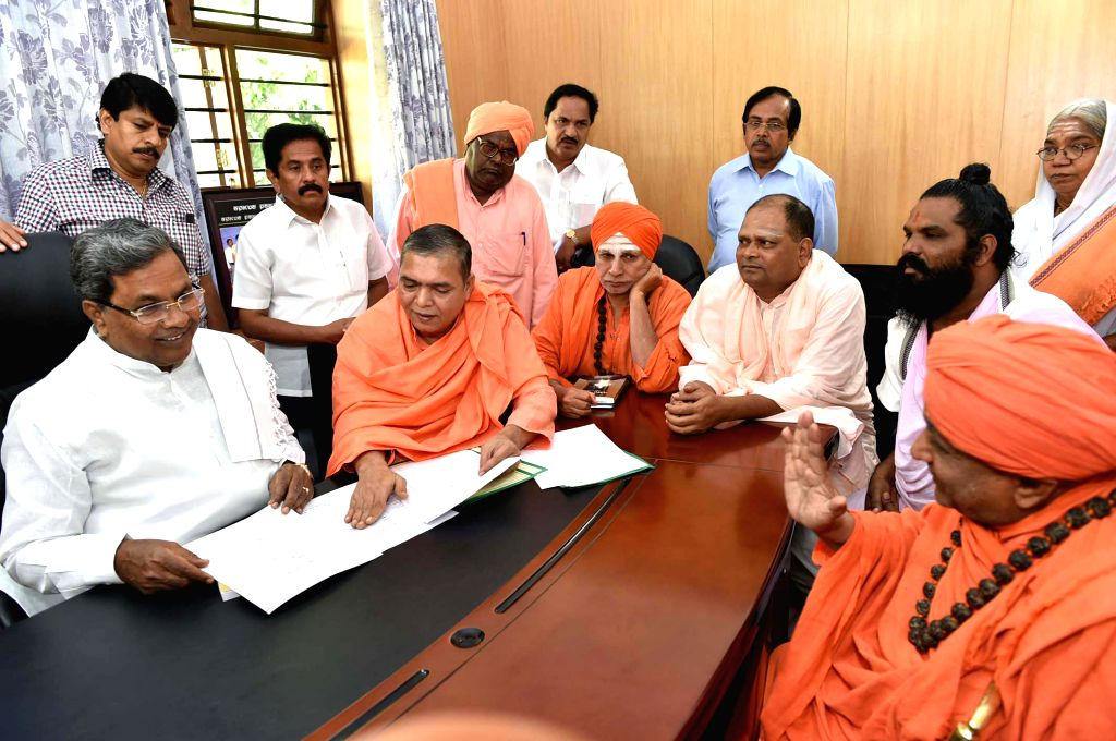 A delegation of ascetics led by Veerabhadra Channamalla Swamiji calls on Karnataka Chief Minister Siddaramaiah in Bengaluru, on Nov 19, 2014. The ascetics met the chief minister to press .. - Siddaramaiah