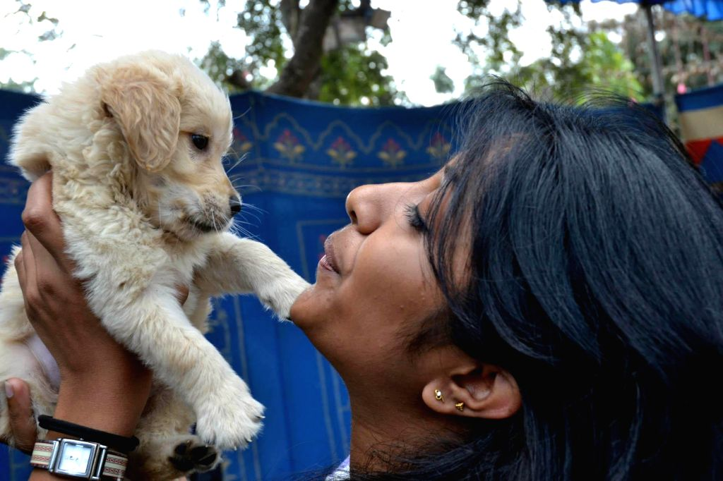 A girl with her pet at `Bangalore Pet Show 2015` in Bengaluru, on Jan 4, 2015.