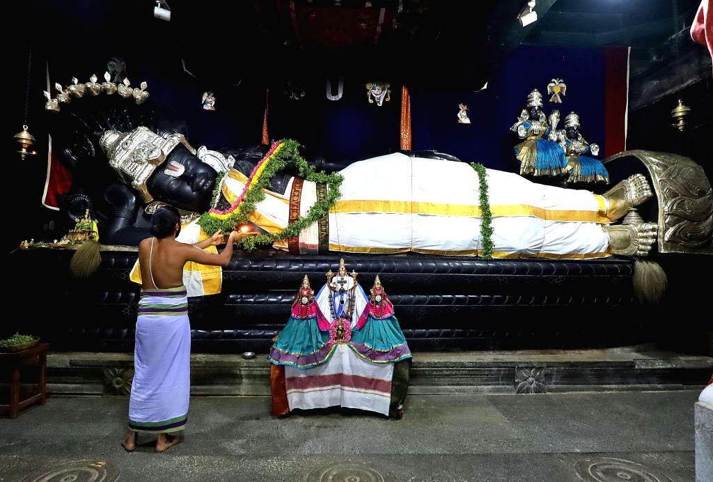 Bengaluru: A priest performs pooja at Bengaluru's Sri Venkateswara Temple that reopened on June 8, 2020. Restaurants, shopping malls, hotels and religious places on Monday threw their doors open to the public over nearly two and a half months after t