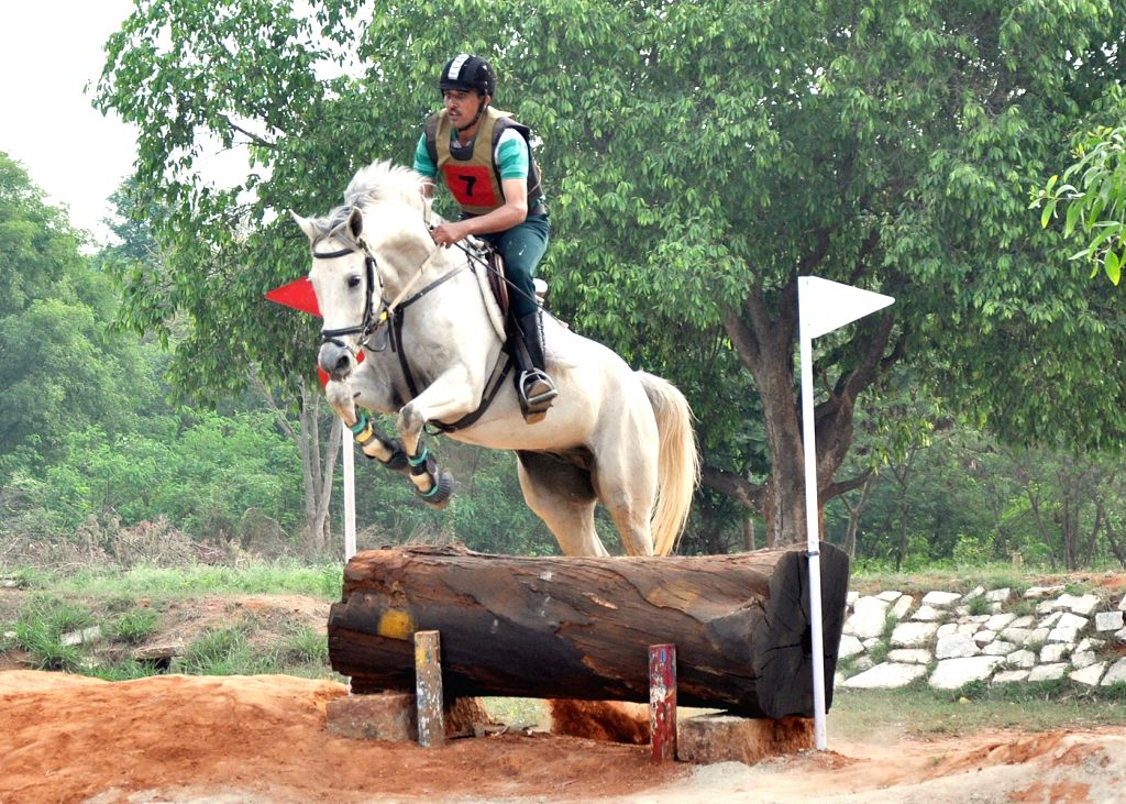 A rider participates in the Cross Country Competition of National Equestrian Championship and Bangalore Horse Show, in Bengaluru on April 23, 2015.