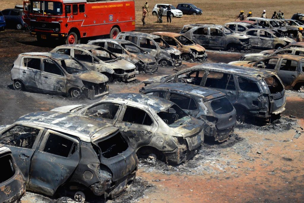 Bengaluru: A view of cars that were gutted in a fire that broke out in the parking lot in front of Yelahanka Air Force Station gutting 300 cars, in Bengaluru on Feb 23, 2019. The fire, which began at around 12 noon, quickly burnt down the vehicles pa
