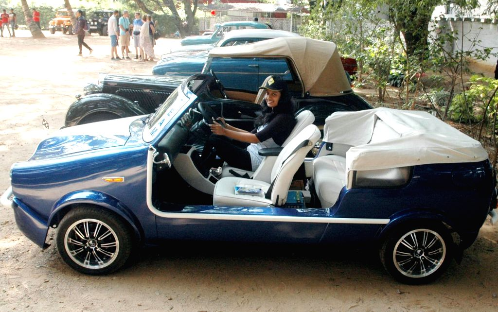 A visitors at the Southern India Vintage Automobile Exhibition organised at  Jayamahal Palace Grounds in Bengaluru, on Nov 23, 2014.