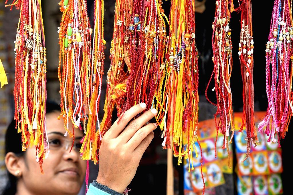 Bengaluru: A woman busy buying rakhis ahead of Raksha Bandhan in Bengaluru on Aug 12, 2019.