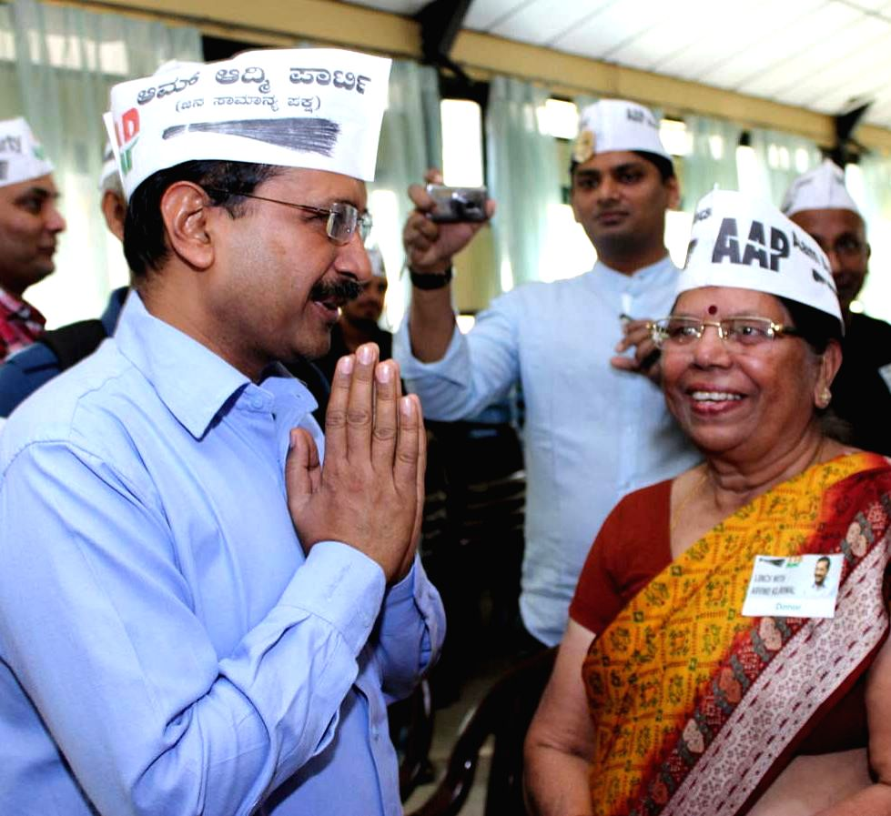 Aam Aadmi Party (AAP) leader Arvind Kejriwal interacts with party leaders during a programme in Bengaluru, on Jan 11, 2015. - Arvind Kejriwal