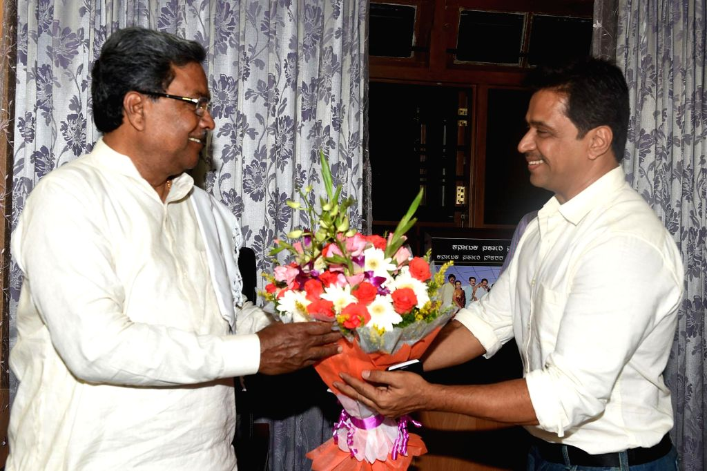 Actor Arjun Sarja calls on Karnataka Chief Minister Siddaramaiah at Home office Krishna, in Bengaluru on Nov. 15, 2014. (Photo : IANS)