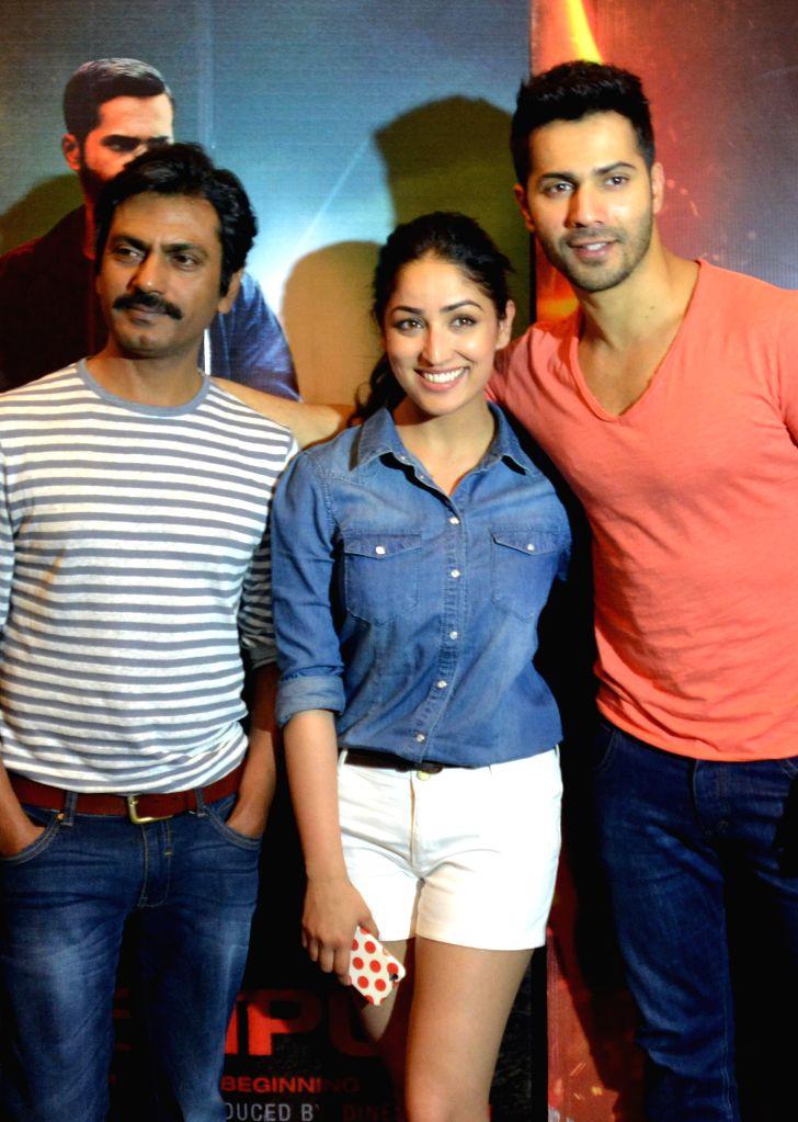 Actors Nawazuddin Siddiqui, Yami Gautam and Varun Dhawan during a promotional event of their upcoming film `Badlapur` in Bengaluru on Feb. 16, 2015. - Nawazuddin Siddiqui, Yami Gautam and Varun Dhawan