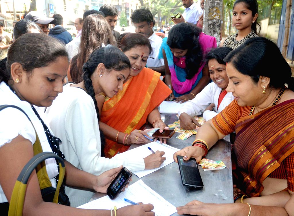 Actress and BJP MLC Tara receives students membership form during a programme organised in Bengaluru on Dec 23, 2014.