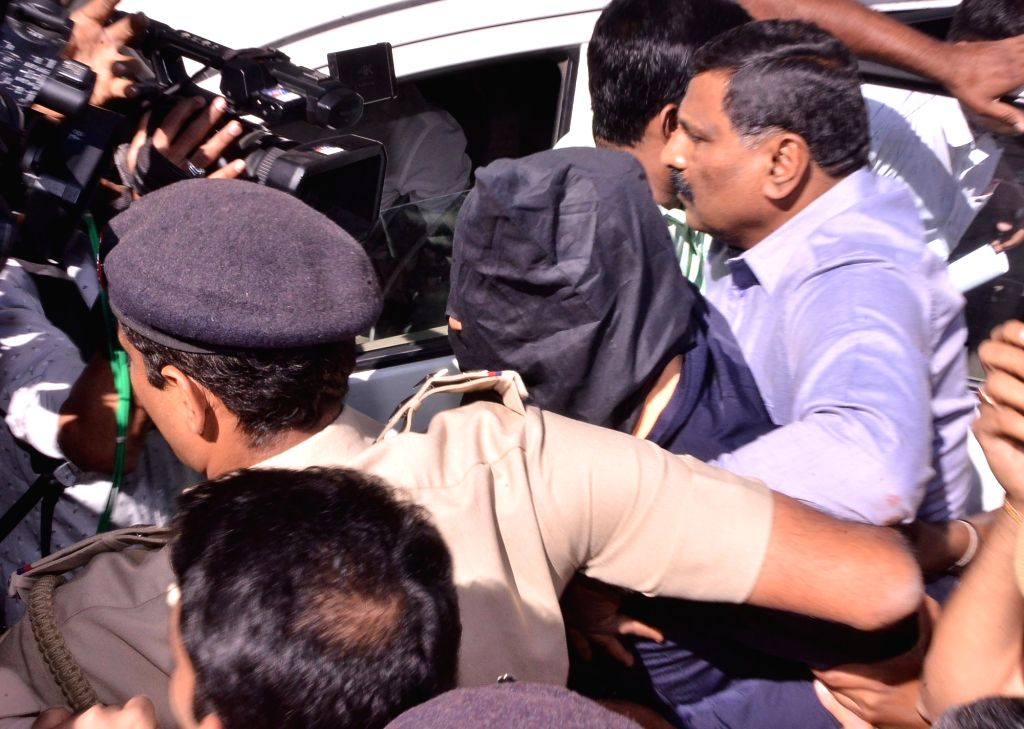 Bengaluru: Aditya Rao, a depressed mechanical engineer who surrendered as the Mangaluru airport bomb suspect, being taken away by the police, in Bengaluru on Jan 22, 2020. He was arrested here when he walked into the Karnataka Director General of Pol - Rao