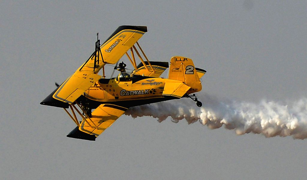 An aircraft perform aerobatics during the Aero India-2015 Air Show, at Yelahanka Air-force Station, in Bengaluru on Feb 21, 2015.