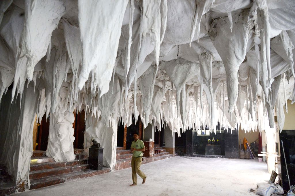 An artificial Amaranth cave being prepared ahead of Mahashivaratri festival at  Mahabalamuri Ganesha Temple in Hanumantha Nagar in Bengaluru, on Feb 15, 2015.