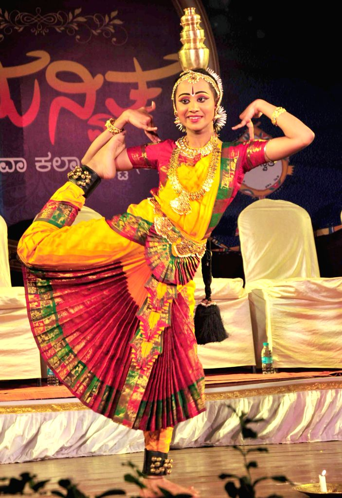 An artist performs during inauguration of `Samanvitha` a cultural programme in Bengaluru on Feb 25, 2015.