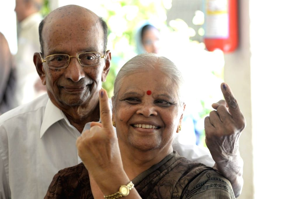 Bengaluru: An elderly couple show the mark of inedible ink after casting votes for the second phase of 2019 Lok Sabha elections, in Bengaluru on April 18, 2019. (Photo: IANS)