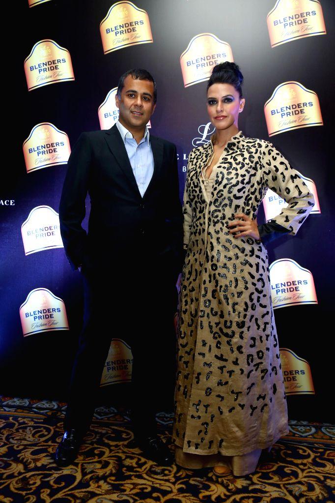 Author Chetan Bhagat and actress Neha Dhupia at Blenders Pride Fashion Tour 2014 in Bengaluru, on Dec 7, 2014. - Neha Dhupia