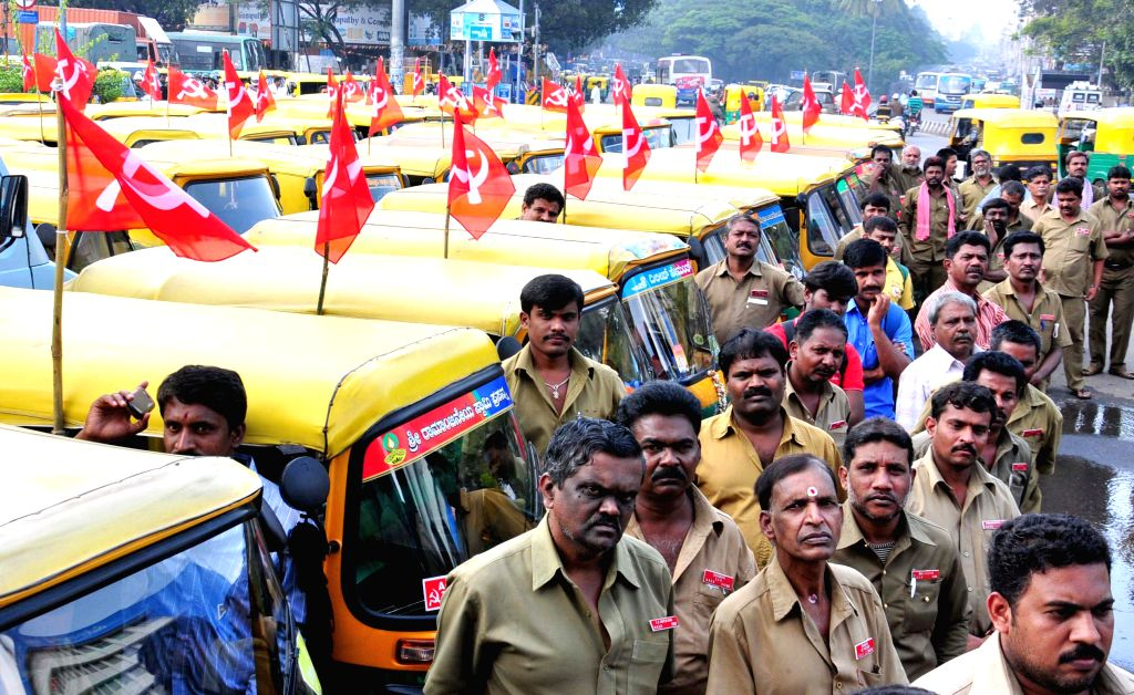 Auto-rickshaw drivers during a programme in Bengaluru on Jan 1, 2015.