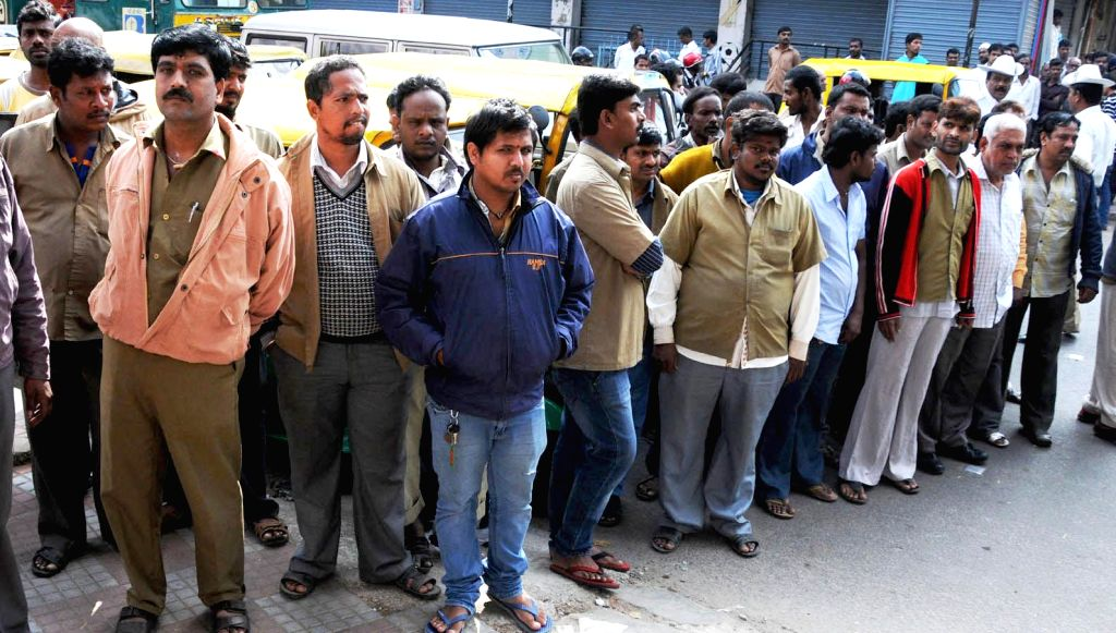 Auto-rickshaw drivers gather outside Upparpet Police Station after police impounded  their vehicles in Bengaluru on Dec 22, 2014.
