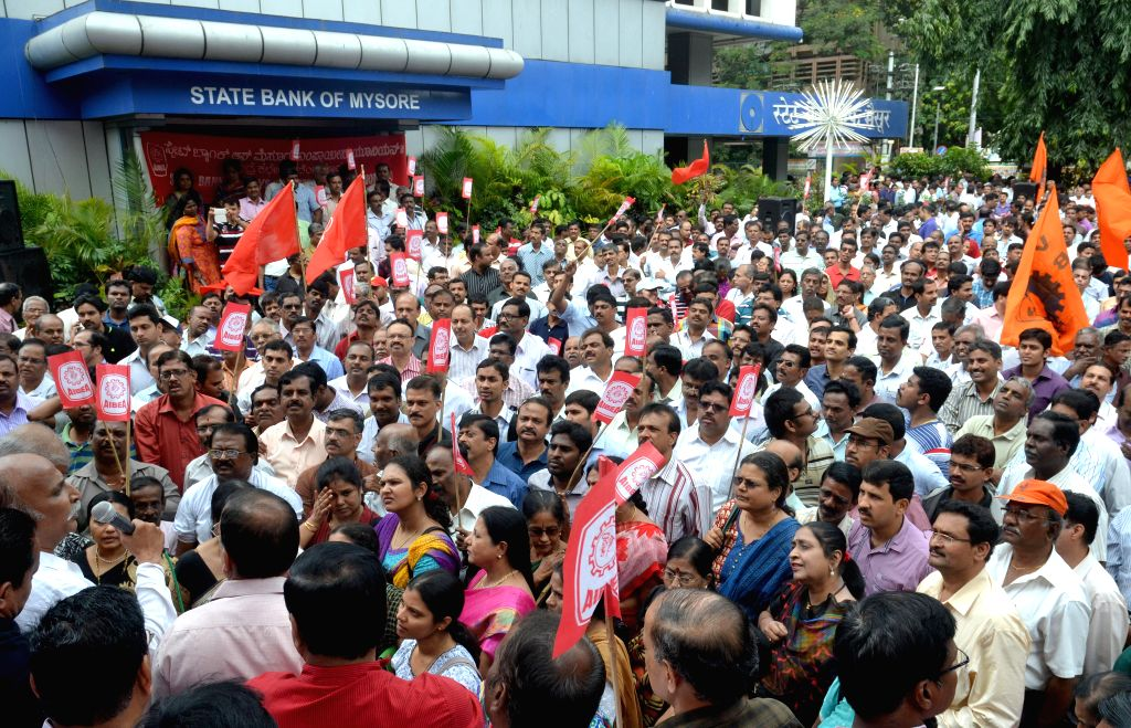 Bank Employees demonstrate in front of a bank during a day-long strike called to press for their demands, including pay revision in Bengaluru, on Nov 12, 2014. Employees of 27 public ...