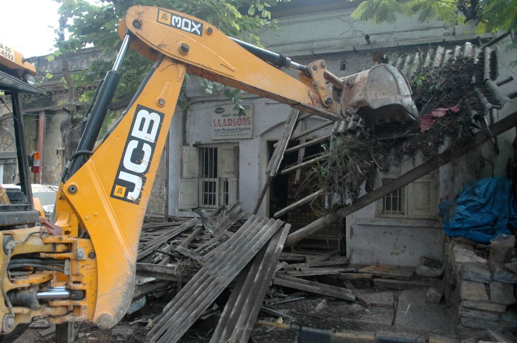 BBMP demolish illegal structures at Bamboo Bazar, in Bengaluru on Nov 18, 2014.