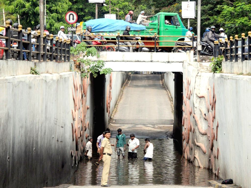 BBMP workers busy clearing a waterlogged underpass in Bengaluru, on March 3, 2015.
