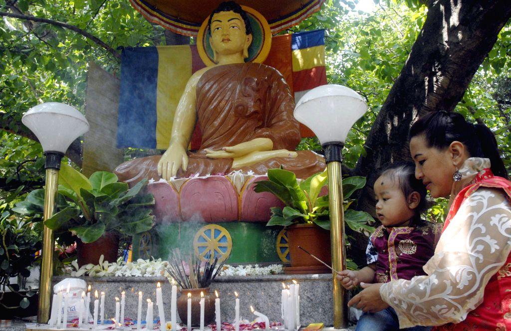 Bengaluru: A Buddhist devotee offers prayer at a temple on Buddha Purnima, in Bengaluru, on May 4, 2015.
