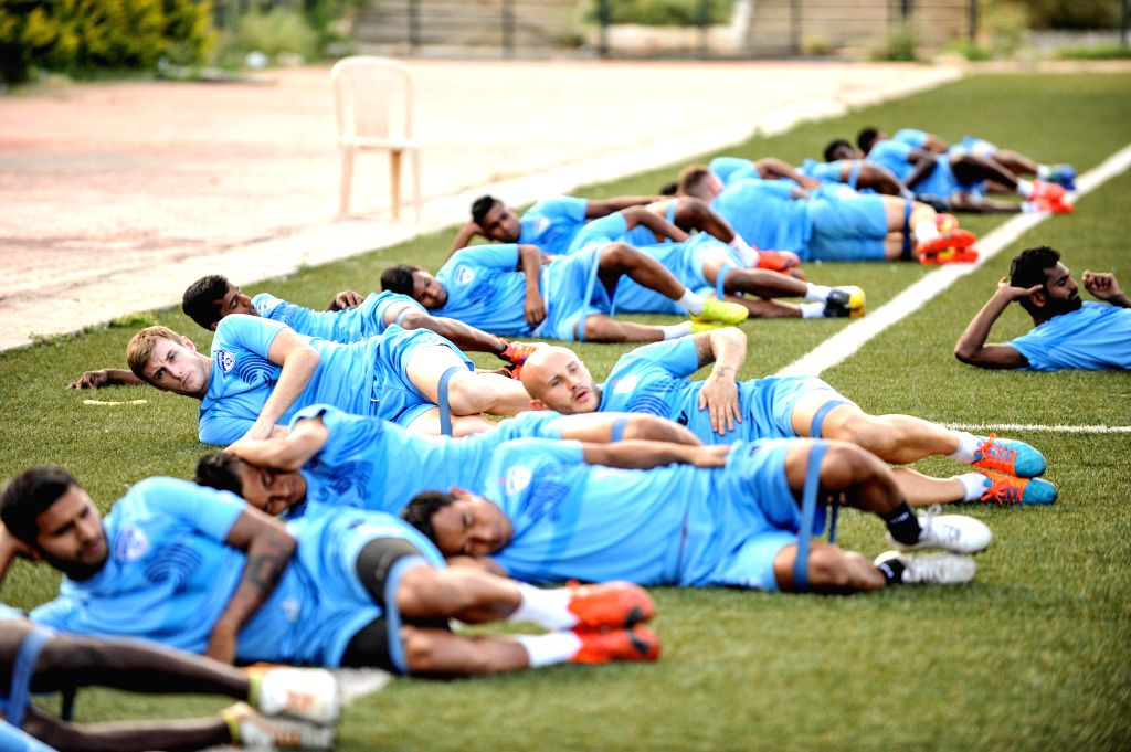 Bengaluru FC players during a practice session ahead of an AFC Cup match against Warriors FC of Singapore on 17th of March 2015 at the Bangalore Football Stadium, in Bengaluru on March 16, ...
