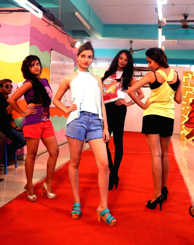 Bengaluru: IIFT students walks the ramp during `Cut T Shirt` - fashion show organised by Indian Institute of Fashion Technology, in Bengaluru, on Jan 14, 2015.