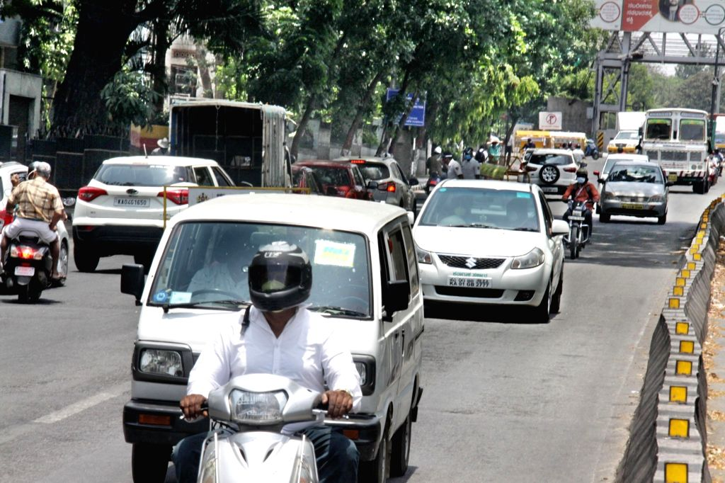 Bengaluru: Bengaluru's JC Road witnesses normal traffic during the extended nationwide lockdown imposed to mitigate the spread of coronavirus; on Apr 22, 2020. (Photo: IANS)