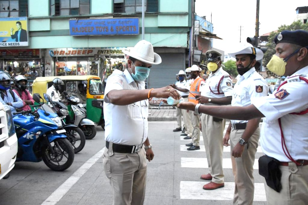 Bengaluru: Bengaluru Traffic police personnel awareness campaign for public using sanitation and hand wash COVID-19 (coronavirus) outbreak in Bengaluru on March 20, 2020 (Photo: IANS)