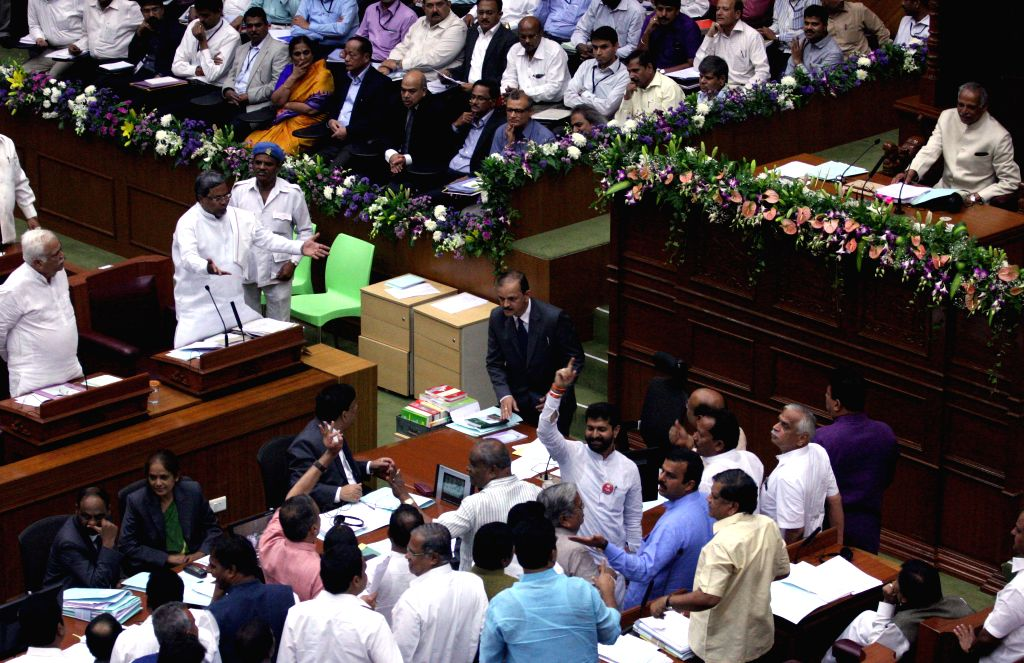 BJP and JD(S) MLAs protests during the winter session of Karnataka assembly at the Suvarna Soudha in Bengaluru on Dec 9, 2014.