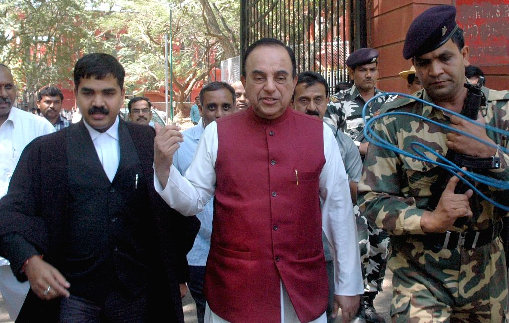 BJP leader Dr. Subramanian Swamy comes out of the Karnataka High Court after submitting his written petition against former Tamil Nadu Chief Minister J Jayalalithaa in disproportionate ... - J Jayalalithaa