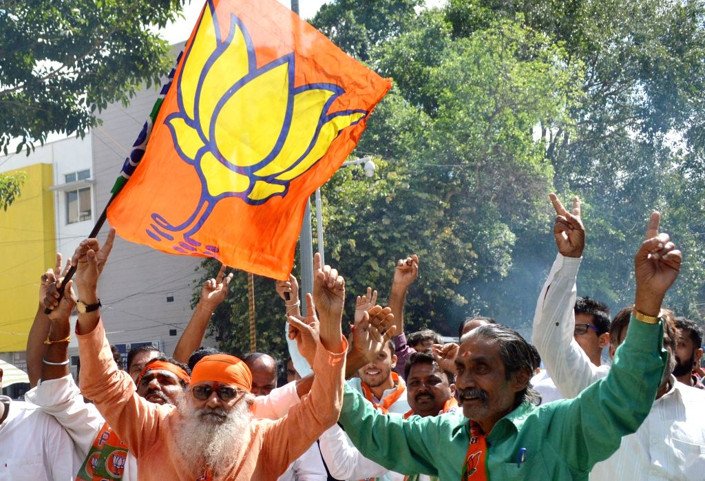 Bengaluru: BJP leaders celebrating after after Karnataka's bye-elections results were announced outside BJP Office in Bengaluru on Dec 9, 2019. (Photo: IANS)