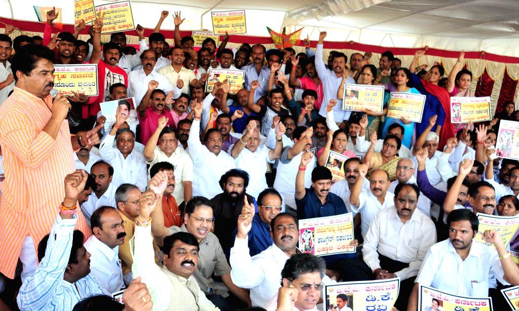 Bengaluru : BJP leaders staging a dharna demanding CBI investigation of IAS officer DK Ravi's suicide case in Bengaluru on March 22, 2015.