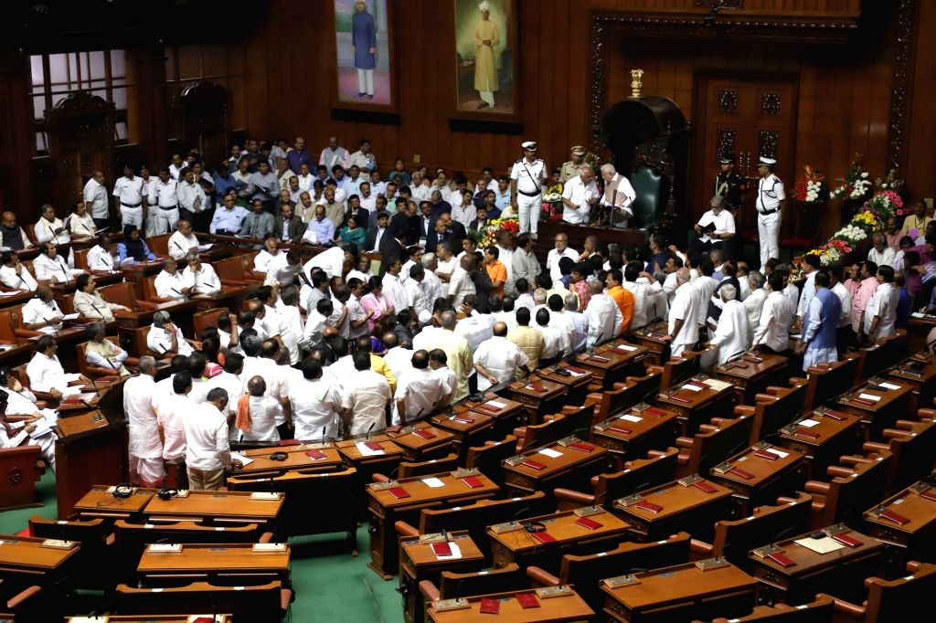 Bengaluru: BJP MLAs create ruckus during Karnataka Governor Vajubhai Vala's joint address to the state assembly Budget Session, in Bengaluru on Feb 6, 2019. (Photo: IANS)
