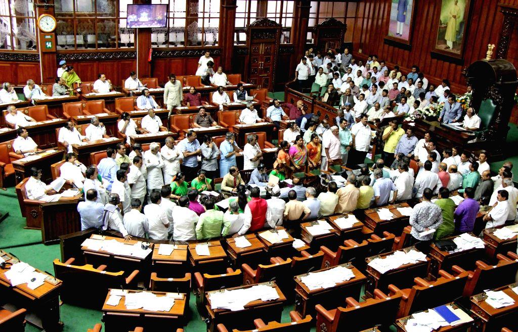 Bengaluru: BJP MLAs protest during budget session of Karnataka assembly in Bengaluru, on Feb 14, 2019. (Photo: IANS)